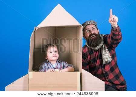 Father`s Day. Happy Family Playing With Cardboard Rocket. Cosmonaut Concept. Cute Boy Playing Cosmon
