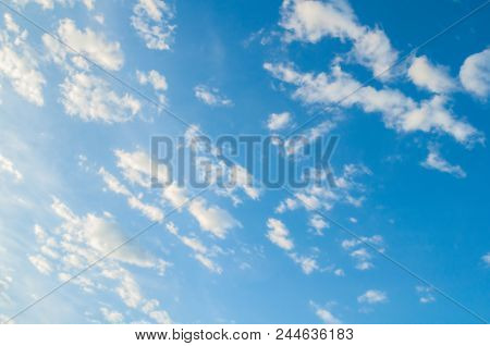 Blue Evening Sky With White Dramatic Clouds - Vast Sky Landscape View. Colorful Evening Blue Sky Wit