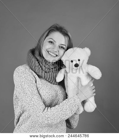 Woman Holds Teddy Bear On Red Background. Tenderness And Beauty Concept. Girl With Happy Face Plays