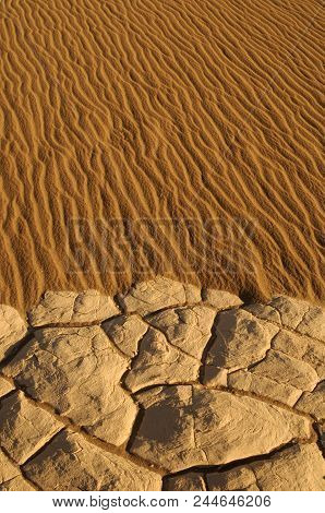 Waves And Cracks In The Dry Sand Make A Beautful Textured Pattern Background