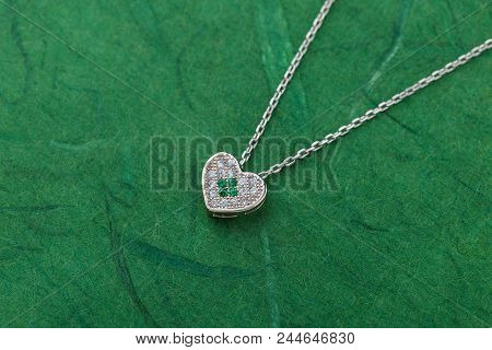 Luxury Silver Heart Necklace With Crystals On Green Background. Bridesmaid Jewelry