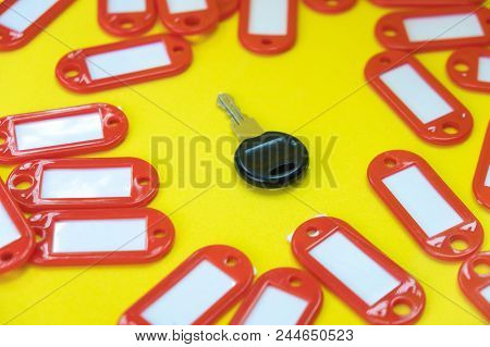 Around The Key There Are Tags For Keys, Around The Empty Keychains For The Identification Of Keys