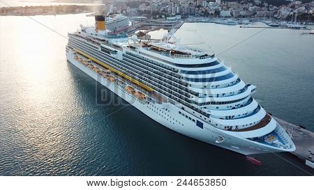 Cruise Ship Sailing Across The Mediterranean Sea. Aerial View Of Luxury Cruise Ship Sailing From Por
