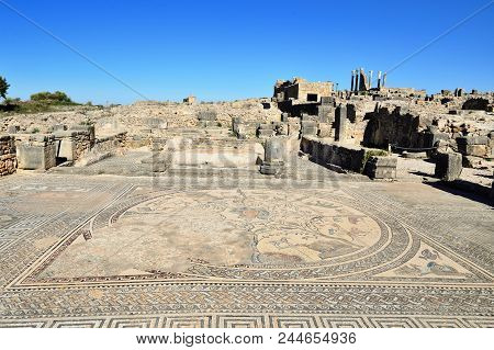 Extensive complex of ruins of the Roman city Volubilis - of ancient capital city of Mauritania in the central part of Morocco by the Meknes city. The photograph presents ancient Roman mosaics poster