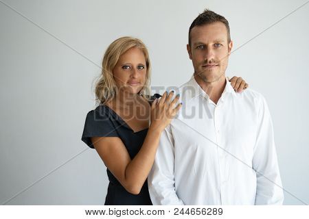 Serious Confident Business Couple Looking At Camera. Successful Company Cofounders In Formalwear Sup