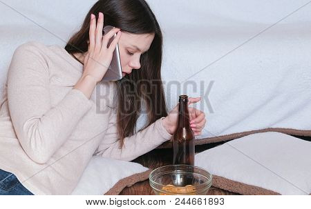 Tough Conversation To Women On The Phone. Young Beautiful Woman Drinks Beer
