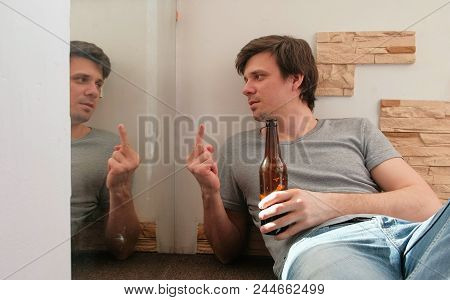 Male Bachelor Drinking Beer And Shows Fuck You To His Reflection In The Mirror