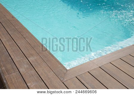 Detail Blue Liner For Swimming Pool With Wood Deck