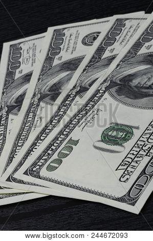 American Dollars In Black Background. Usd 100 Dollars Background. Dollars Cash
