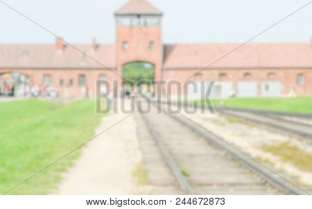 Defocused Background Of The Nazi Concentration Camp In Auschwitz-birkenau, Poland. Intentionally Blu