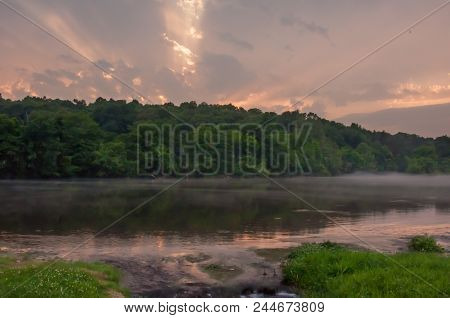 Sunset Over The Misty Spring River In Arkansas