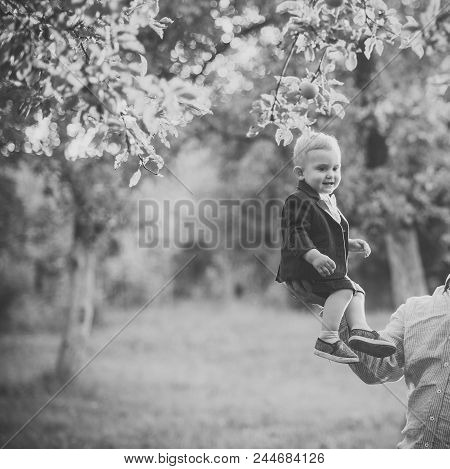 Child Childhood Youth. Kid Fashion, Beauty, Style. Trust, Love, Family. Small Boy Sit On Male Hand I