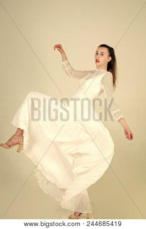 Wedding Dresses. Woman With Long Brunette Hair And Red Lips. Girl In White Fashionable Dress. Beauty