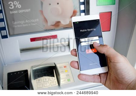 Withdraw Money From An Atm Without Using A Credit Card. Person Holding A Phone With A Login Screen F