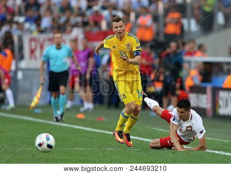 Marseille, France - June 21, 2016: Ruslan Rotan Of Ukraine (l) And Bartosz Kapustka Of Poland In Act