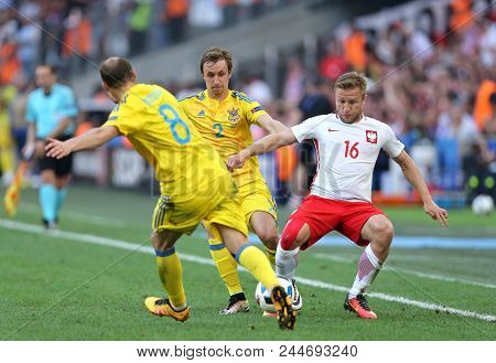 Marseille, France - June 21, 2016: Roman Zozulya And Bohdan Butko Of Ukraine Fight For A Ball With J