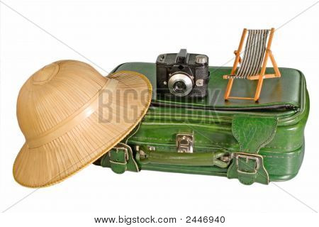 An old suitcase with a safari hatwear antique camera and a miniature deckchair poster
