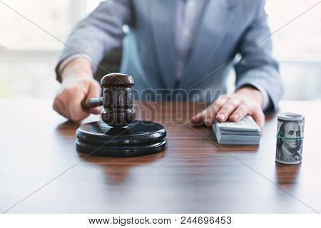 Punishment For Bribery. Law-abiding Moral Official Touching Money And Touching An Inscribed Gavel