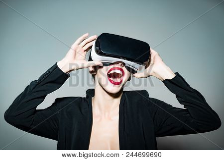 Happy Woman In Virtual Reality Headset Isolated On Grey Background. Beautiful Attractive Girl In Vir