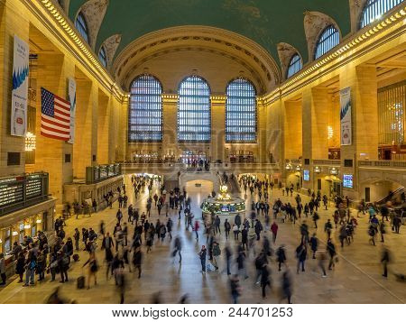 New York, New York - March 27, 2018: Commuters And Tourists In The Grand Central Station. It Is The