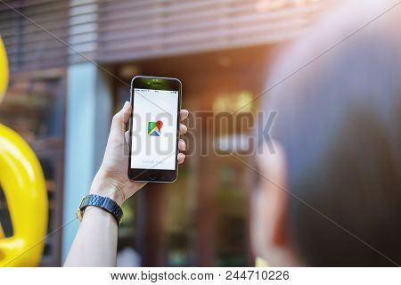 Chiangmai , Thailand - 3 June 2018: A Man Hand Holding Screen Shot Of Google Maps App Showing On Iph