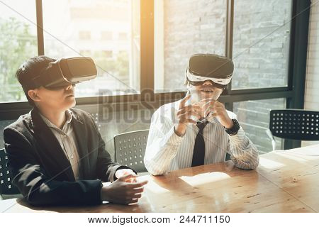 Two Business Business Persons With Virtual Reality Headsets In The Office.