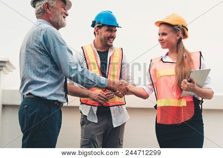 Project Management Team Of Engineers And Architects Are Handshake Together After Dealing Their Proje