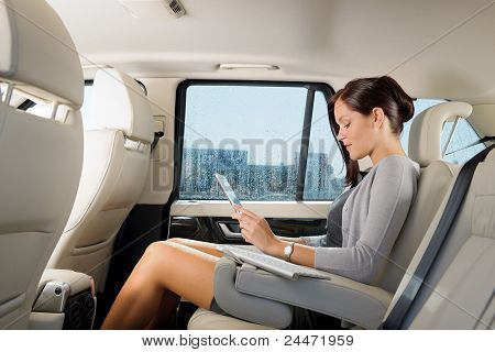 Executive Businesswoman In Car Work Touch Tablet