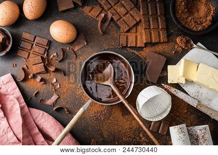 Top View Of The Process Of Cooking Chocolate Bakery Pastry With Melting Chocolate. Ingredients For C