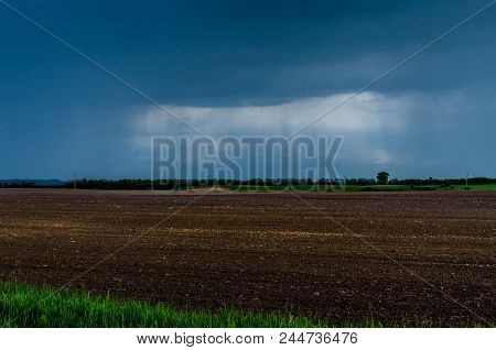 Rain Pours On The Fields. Rain Clouds Over Fields. Spring Fields Are Ready For Sowing