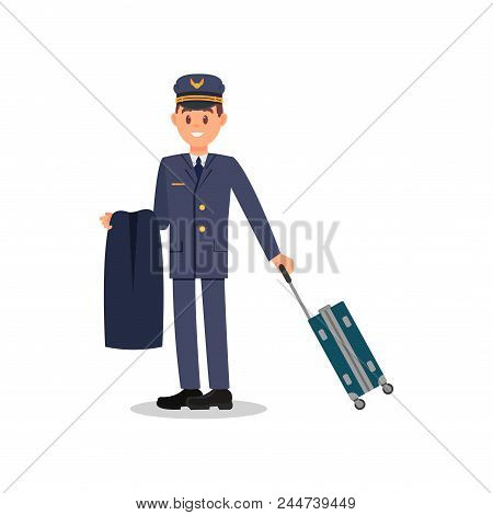 Young Cheerful Pilot Holding Jacket And Suitcase On Wheels. Male Captain In Blue Suit And Cap. Worke