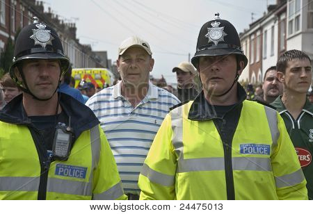 Devon And Cornwall Police escort football fans to prevent football violence at a League 1 Match
