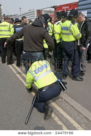 Plymouth Argyle Supporter being searched by Police at a League 1 match