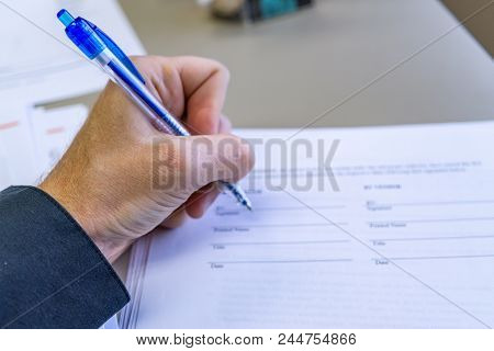 Signing A Contract Or Document In Office Setting Close-up