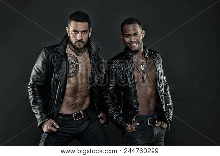 Men On Smiling Faces With Bristle And Tattoos. Fashion And Style Concept. Machos With Muscular Torso