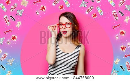 Portrait Of Beautiful Surprised Young Woman In Glasses On The Wonderful Pink Studio Background And W