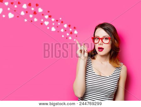 Portrait Of Beautiful Surprised Young Woman In Glasses On The Wonderful Pink Studio Background And A