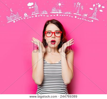 Portrait Of Beautiful Surprised Young Woman In Glasses On The Wonderful Pink Studio Background And T