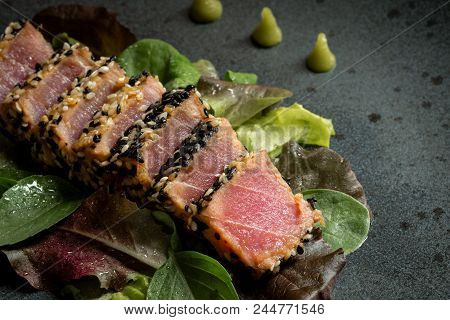 Grilled Sliced Tuna Steak In Sesame With Salad And Wasabi Sauce