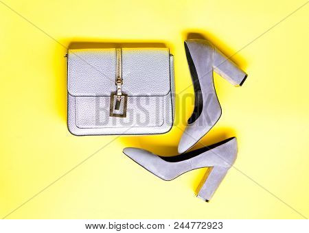 Fashionable Accessories Concept. Pair Of Fashionable High Heeled Shoes And Silver Purse. Shoes Made