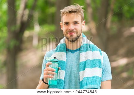 Drink Some Water. Man Jogger With Towel On Shoulders Holds Water Bottle. Man Athlete Sport Clothes R