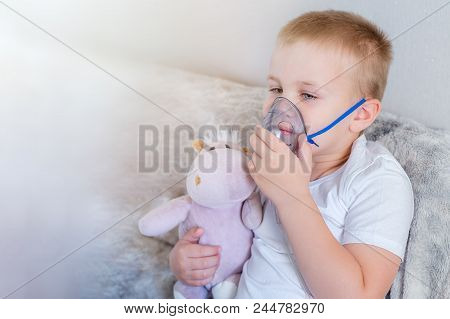 Little Boy Does Inhalation At Home With His Favorite Toy, Boy Has Problems With Asthma And He Use In