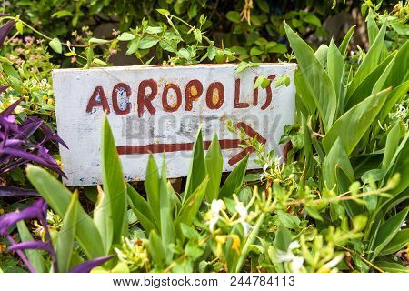 Handmade Signpost Pointing To The Acropolis In Anafiotika Area Of Plaka District, Athens, Greece. Pl
