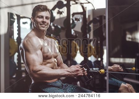 Handsome Strong Bodybuilder Athletic Men Pumping Up Muscles With Dumbbells
