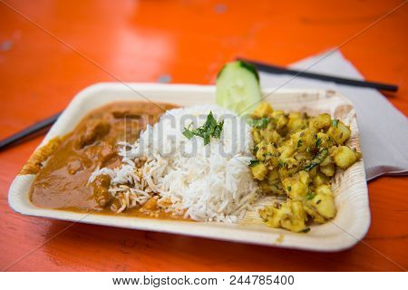 Street Food - Curry With Rice And Potatoes In A Bowl