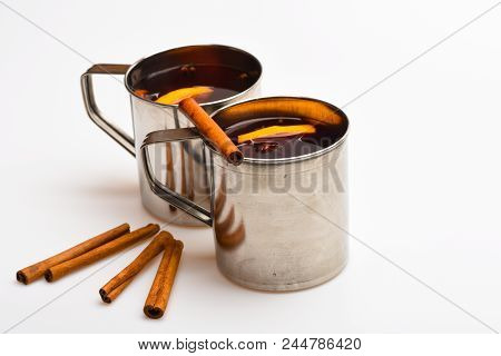 Tea Or Hot Drink In Metal Mug With Slise Of Orange. Mulled Wine Or Beverage With Cinnamon And Anise.