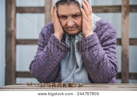 Money, Coins, Grandmother Pensioner And The Concept Of Subsistence Minimum - Old Woman Sad Looking A