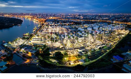 Aerial View Of Oil Refinery Near International Port At Night. Panorama Of Refinery Plant At Night. R