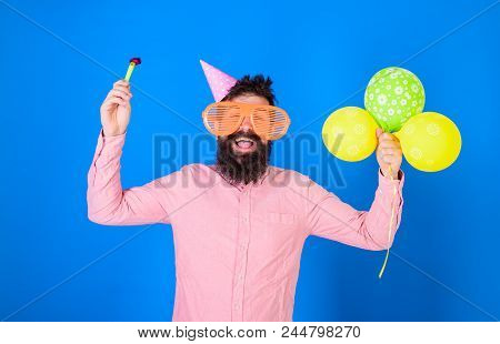 Hipster In Giant Sunglasses Celebrating Birthday. Man With Beard And Mustache On Happy Face Holds Pa