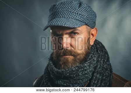 Male Fashion. Handsome Man In Hat And Scarf. Winter Fashion. Attractive Bearded Man In Warm Knitted
